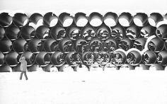 Sections of pipe form a geometric dazzlement stacked in a Fairbanks, Alaska storage yard on May 30, 1974. They'll form a line 789 miles long across Alaska from the Arctic Ocean oil fields to the ice-free harbor at Valdez.