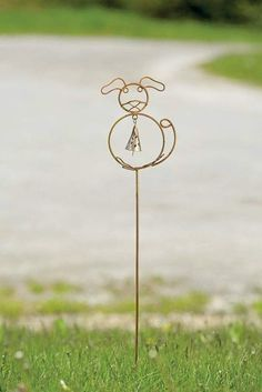 Pay homage to your favorite friend! Our Flamed Dog with Bell Garden Stake makes a whimsical addition to any outdoor space. Sculpted of stout wire in a flamed metal finish, it includes a tapered bell that chimes merrily with passing breezes. #GardenStakes #Gardenstake #gardenstake #gardenstakes #gardening #gardenlover #gardenart Garden | Gardening | Garden Art | Garden Decor | Garden Stake