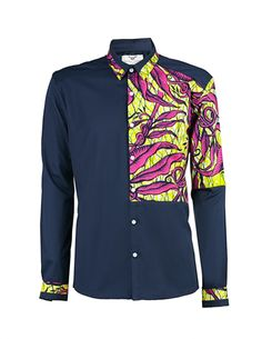Men's African print shirt-Slim fit. Real wax African print contrast block detailing Colour: Navy 80% Cotton 20% Nylon Machine washable 30 degrees reduced spin Please note that the appearance of motifs may at times differ slightly from photographed image.