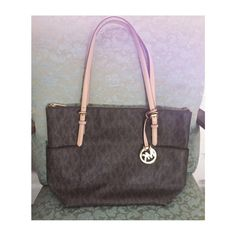 REDUCED! Michael Kors Jet Set EW Top zip tote, signature print in brown. Approximately 11x11.5x3.75.  One interior cell phone pocket, zip pocket, 3 slip pockets. Exterior has slip pockets on both sides. Excellent condition barely used. No stains. Michael Kors Bags Totes