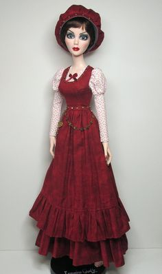 """Edwardian style outfit in red for Evangeline. This has been given a slight steampunk flavour with metal embellishments. This is my first Evangeline outfit, and fits the NEW VINYL/PLASTIC 18"""" GIRLS. (If you have Evangeline Midnight Lace & Roses, Dreamstate, or Angelique De la Nuit - these are the three dolls I own. This pattern will fit that style of body.) OVERDRESS: In red mottled quilters-weight cotton, bodice is lined with cotton voile. Fastens in back with snaps. Real metal studs in…"""