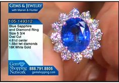 Sapphire lovers here is the ring for you. A stunning 4.6 carat blue sapphire surrounded by 1.5 carats of white diamonds set in 18k white gold. Very fine.
