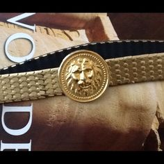 """Vintage metal belt from 1990. I remember these metal belts well..... Lol! This one stretches due to the elastic on the underside of the belt. The top side has metal scales and a very cool lion head buckle. It measures 26"""" end to end unstretched but it stretches easily to 32"""" long comfortably and can be worn by S/M all the up to an XL. The last picture shows 1990 date underneath near buckle. Vintage Accessories Belts"""