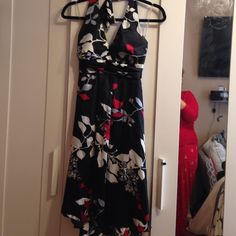 Floral dress in satin material , ties at neck Floral dress in blk red white and silver. Beautiful design. Ties at neck with gathering below bustline. Had sash bow in back. Looks great on, worn once. WINDSOR Dresses Midi