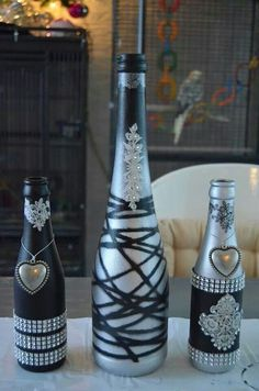 "Wine bottle centerpieces for that ""Champagne taste on a beer bottle budget. Wine Bottle Glasses, Empty Wine Bottles, Wine Bottle Corks, Glass Bottle Crafts, Painted Wine Bottles, Diy Bottle, Bottles And Jars, Glass Bottles, Decorated Wine Bottles"