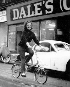 Scots singer-actress Dorothy Paul tries out a Moulton bike outside Jim Houston's Dales Cycle shop in Shamrock Street, Glasgow