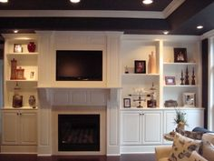 Custom Entertainment Center. Maple Painted White, designed by Cord's Cabinetry