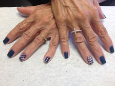 Blue with red white and blue pull through design on accent nails  Oasis Salon and Spa Mill Hall Pa (570)726-6565
