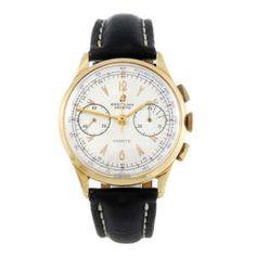 LOT:21   BREITLING - a gentleman's yellow metal Cadette chronograph wrist watch.