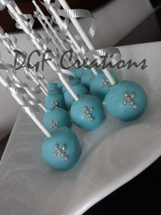 Beautiful blue red velvet cakes pops with little silver candy pearls in a cross shape for boy confirmation. www.facebook.com/dgfcreations