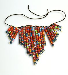 Necklace made from newspapers, glossy inserts and magazines.