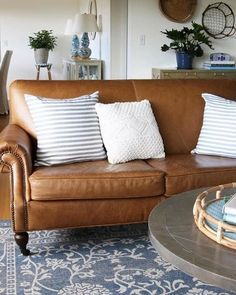 Our Brooklyn Leather sofa looks like it was made for @theinspiredroom living room.  The toffee leather is the perfect neutral shade for the space and the perfect backdrop to play with mixing pillows.  Better yet?  The sofa is now on sale during our Premier Day! Check out the site for 100s of other deals but hurry as they expire at midnight! #leather #leathersofa #mypotterybarn #lovemypotterybarn #premierday #sale
