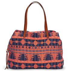 Oversized, tribal woven print tote bag with shoulder straps and zipper closure.