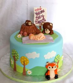 I love this.  The colors and the little fox!  The little hedgehog on the log is adorable and the baby bear!!!  Maybe use this as the bottom layer? Baby Shower Cake- woodland forest animals