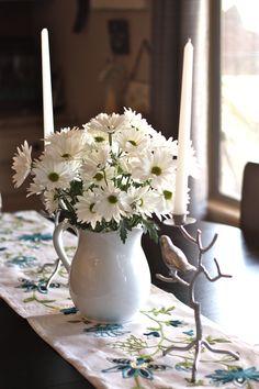 A summer centerpiece: Candlesticks $4.99 and Water pitcher $2.99 from #Goodwill.  #thrift #decor #table