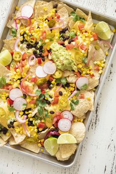 Vegetarian Sheet Pan Nachos Vegetarian Nachos, Vegetarian Bake, Vegetarian Entrees, Onion Recipes, Mexican Food Recipes, Mexican Dishes, Chicken Parmesan Meatloaf, Pickle Onions Recipe, One Pan Dinner Recipes