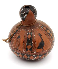 Africa | Gourd (Calabash) container from the Tonga people from the Lourenço-Marquès region of Mozambique | 19th century | Gourd, pigment and white glass beads.