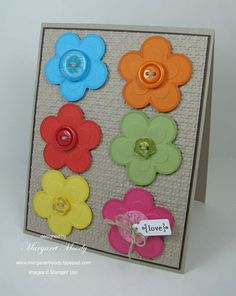 Colorful embossed flowers with buttons.