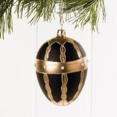 1 boule de noël Noir et dorée forme allongée très joli