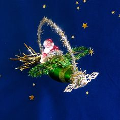 Santa in Airplane Christmas Ornament In Glittered Green and Gold and Silver with Crystals Vintage Style Christmas Tree Ornament L133 by SparkleDeluxe on Etsy https://www.etsy.com/listing/251960831/santa-in-airplane-christmas-ornament-in