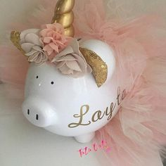 Unicorn tutu piggy Bank! A must have for all unicorn owners! This piggy is wearing a light Pink, light purple and aqua tutu. It also has a unicorn horn and flowers attached. Bank has a removable stopper so no need to break when its time to remove money. Colors can be changed upon request.