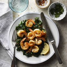 Shrimp spinach and garlic brown and cook quickly for a simple one-pot weeknight dinner. A fast pan sauce gets life from zesty lemon juice warm crushed red pepper and herby parsley. Clean Eating, Healthy Eating, Healthy Food, Eating Well, Healthy Dishes, Shrimp Recipes, Fish Recipes, Garlicky Shrimp, Brunch
