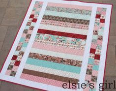pretty in pink- looks like a quilt that could be cranked out quickly, with pretty results - would make a great baby quilt