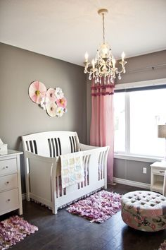 Adore the paper fan wall decor in this fab nursery! #nursery #glam