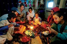 An Afghan family breaks the fast for Ramadan with an evening meal