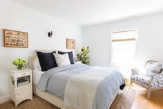 """We love hosting so an inviting guest bedroom was key. Oversize pillows and a patterned duvet scream """"Jump on in!"""""""