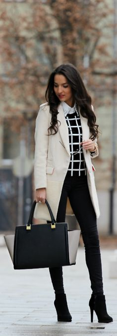 White coat, black skinny pants, b/w sweater and high heel booties. great look. Love the modern color block purse.