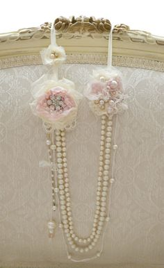 This listing is for one beautiful pearl and ribbon work necklace handmade by Jennelise Rose. This necklace hangs from an ivory silk ribbon with two