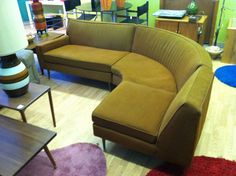 Curved brown sectional MidCentury sofa at Mad Modern