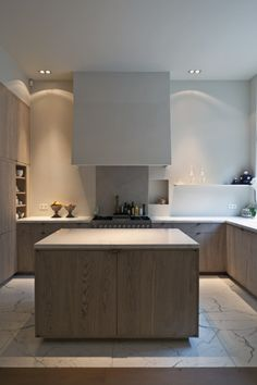Perfect kitchen for large format Marble flooring and tops. Love the open simplicity and tall storage wall.
