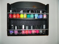 Spice rack turned nail rack! - My own creation. Used sparkle scrapbook paper for the background!