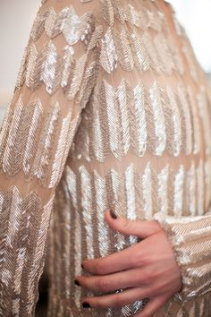 Chevron Beading - sheer beaded dress - couture embellishments; closeup fashion…