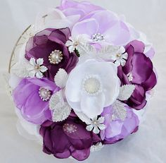 Handmade floral bouquet in lilac, dusky purple and white with hand beading.