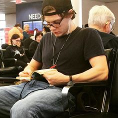 Evan Peters with glasses. How does he make sitting look so sexy?