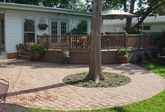 Brick paver patio with tree | MasterScapes®