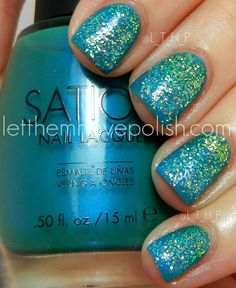 I started with Two coats of Sation Miss McTeal, which I am holding in this picture and is totally droolworthy! I then did a gradient with Miss McTeal and Sation Board Girl Blue. The gradient was very subtle deep Teal to Blue. THEN things got fun! I grabbed Three of my new glitter pots. I went for the Green, Blue and Light Blue.