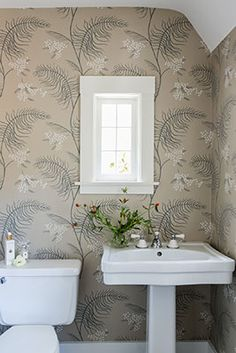 Wallpapered powder room. Interior Design by @Kress Jack at Home,  Photography by @Catherine Nguyen Photography