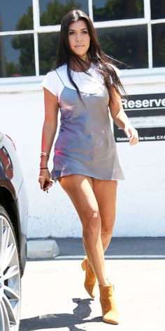 Kourtney Kardashian Flaunts Her Toned Gams in a Super Short Slip Dress from InStyle.com