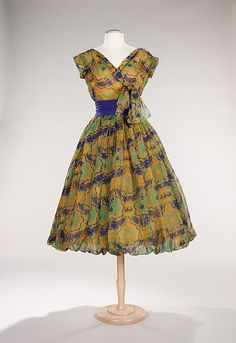 Cocktail dress Design House: House of Dior (French, founded 1947) Designer: Christian Dior (French, Granville 1905–1957 Montecatini) Date: spring/summer 1956 Culture: French Medium: silk, synthetic