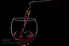 Wine glasses with wine bottle on a black background minimalism by oleghz