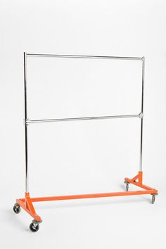 Orange Garment rack - We have a ton of these at work. I wish ours had the bar in the middle.