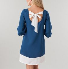 Simple, stylish shift dress with room to breathe :). Could do without the bow