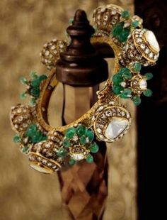 This bangle from collection has been created keeping in mind the modern Jodha Bai who exuded supreme royalty and utmost pride in her 'Adaa'. We are elated to share that this bangle won the 'Best Bracelet Design' award at JJS Wedding Jewellery Inspiration, Indian Wedding Jewelry, Indian Jewelry, Bridal Jewelry, Kundan Bangles, Gold Bangles, Antique Jewellery Designs, Jewelry Design, Stylish Jewelry