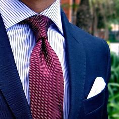 What a great combination. Dark blue suit with a light blue shirt and a deep red or burgundy tie. Great winter look.
