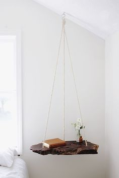 DIY Furniture Projects You Can Do In A Day #refinery29  http://www.refinery29.uk/diy-home-decor-projects#slide-5  Hanging TableLooks pretty adventurous, but it's actually one of the easier projects – the only tricky thing would be sourcing a slice of wood like this one. Then you just need some rope and to install a heavy duty hook in the ceiling. See the step by step here.Time: <...