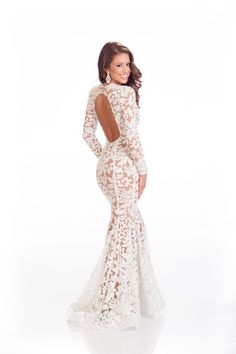 Backless long sleeve wedding gown made with embroidery and  beaded lace. This white lace dress could be recreated in any color of fabrication. www.dariuscordell.com